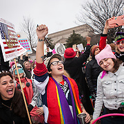 Protesters danced and sang in the street as Natalie de Leon, of Sisters of Liberty, second from left, egged demonstrators on with a microphone in between songs on the corner of 7th and Madison, near the National Mall, during the Women's March on Washington where an anticipated 200,000 people turned into an estimated 500,000 to 1 million people, on Saturday, January 21, 2017.  John Boal Photography