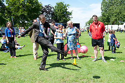 Steve Cram tries out the shooting practice stall, ran by Lincoln City's Sport and Education Trust, in the Sports Zone.<br /> <br /> Steve Cram spent the day at the Lincolnshire Show with Clydesdale Bank and Yorkshire Bank.  He also visited the Sports Zone, at the show, which was organised by Lincolnshire Sport.<br /> <br /> Picture: Chris Vaughan/Chris Vaughan Photography<br /> Date: Wednesday, June 24, 2015