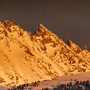 The Sawatch Range turns orange during a clearing winter storm sunset in Eagle Colorado.