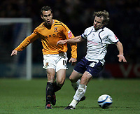 Photo: Paul Thomas/Sportsbeat Images.<br /> Preston North End v Hull City. Coca Cola Championship. 04/12/2007.<br /> <br /> Hull's Richard Garcia passes the ball by Paul McKenna (R).