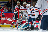 KELOWNA, BC - OCTOBER 12: Orrin Centazzo #19 of the Kamloops Blazers knocks Roman Basran #30 of the Kelowna Rockets into the net during first period at Prospera Place on October 12, 2019 in Kelowna, Canada. (Photo by Marissa Baecker/Shoot the Breeze)