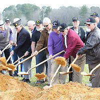 Thomas Wells | BUY at PHOTOS.DJOURNAL.COM<br /> Veterans take their turn to officially break ground for the new Vietnam War Memorial wall at Veterans Park in Tupelo.