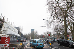 London, UK. 22 January, 2020. A taxi rank in front of Euston station was built on the site of Euston Square Gardens as part of preparatory works for the HS2 high-speed rail line. There has been considerable land purchase and clearance in the Euston area, requiring the destruction of dozens of mature plane trees. Cost projections for the project are reported to have risen to £106bn and the Transport Secretary Grant Shapps has confirmed that the Government will make a decision regarding its viability in February 2020.