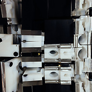 Different blocking jigs for holding various pieces and parts during the milling process.