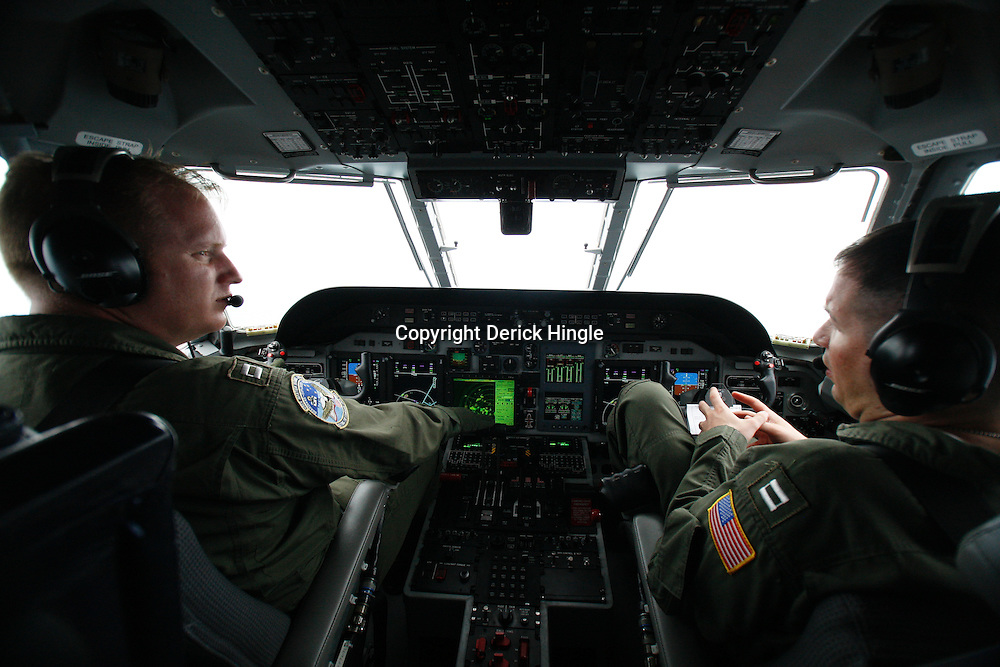 U.S. Coast Guard pilots Lt. Andy Greenwood (left) and Lt. Peter Loge (right) the Aviation Training Center in Mobile, AL fly over the site of the Deepwater Horizon oil spill in the Gulf of Mexico near the coast of Louisiana, U.S., on Wednesday, June 2, 2010. BP Plc has given up trying to plug its leaking well in the Gulf of Mexico any sooner than August, laying out a series of steps to pipe the oil to the surface and ship it ashore for refining, said Thad Allen, the U.S. government's national commander for the incident. Photographer: Derick E. Hingle