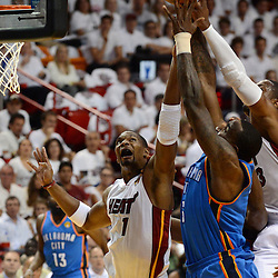 Jun 17, 2012; Miam, FL, USA;  Oklahoma City Thunder center Kendrick Perkins (5) drives against Miami Heat power forward Chris Bosh (1) during the first half in game three in the 2012 NBA Finals at the American Airlines Arena. Mandatory Credit: Derick E. Hingle-US PRESSWIRE