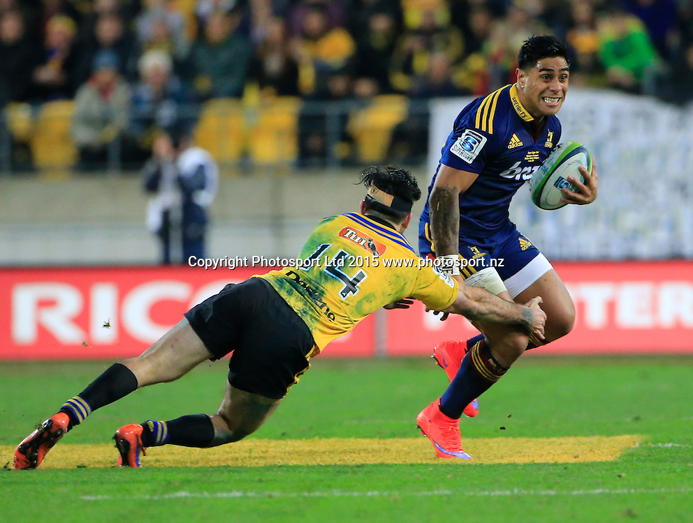 Malakai Fekitoa is tackled by Nehe Milner-Skudder. Super Rugby Final, Hurricanes v Highlanders. Westpac Stadium, Wellington, New Zealand. 4 July 2015. Copyright Photo: John Cowpland / www.photosport.nz