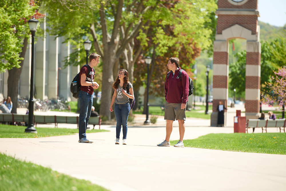 Josh Stanke; Katie Rascher; Bryce Hartl; Activity; Socializing; Walking; Buildings; Clock Hoeschler Tower; Location; Outside; Smiling; People; Student Students; Woman Women; Man Men; Spring; May; Time/Weather; sunny; Type of Photography; Candid; Lifestyle; UWL UW-L UW-La Crosse University of Wisconsin-La Crosse