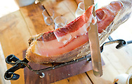 Slicing Istrian ham (spaletta, prepared from the pork foreleg, whereas the more famous prsut is made using the hindleg). Ranch Goli Vrh, near Buje, Istria, Croatia