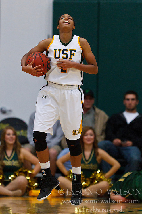 Nov 16, 2011; San Francisco CA, USA;  San Francisco Lady Dons guard Taj Winston (2) reacts after a play against the Cal Poly Mustangs during the second half at War Memorial Gym.  Cal Poly defeated San Francisco 80-66. Mandatory Credit: Jason O. Watson-US PRESSWIRE