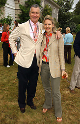 "ARNAUD & CARLA BAMBERGER at the Goodwood Festival of Speed on 9th July 2006.  Cartier sponsored the ""Style Et Luxe' for vintage cars on the final day of this annual event at Goodwood House, West Sussex and hosted a lunch.<br />