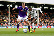 Fulham defender Ryan Sessegnon (3) keeps the ball away from Bolton Wanderers defender David Wheater (31) during the EFL Sky Bet Championship match between Fulham and Bolton Wanderers at Craven Cottage, London, England on 28 October 2017. Photo by Andy Walter.