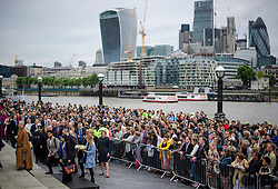 © Licensed to London News Pictures. 05/06/2017. London, UK. A vigil at Potters Fields Park outside City Hall in London for those who lost their lives in the London Bridge terror attack. Three men attacked members of the public  after a white van rammed pedestrians on London Bridge. Ten people including the three suspected attackers were killed and 48 injured in the attack. Photo credit: Ben Cawthra/LNP