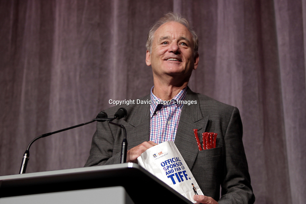 Actor Bill Murray with popcorn in hand and red liquorice in pocket makes the audience roar with laughter while on stage at the 'Hyde Park On Hudson' premiere during the 2012 Toronto International Film Festival at Roy Thomson Hall, September 10th. Photo by David Tabor/ i-Images.