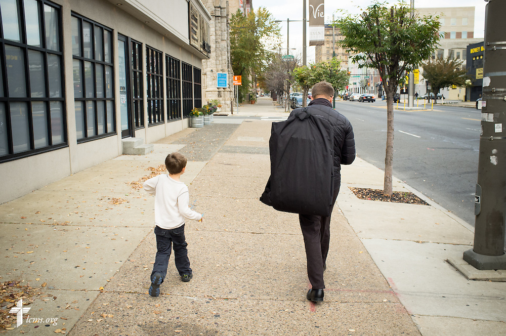 The Rev. Adam DeGroot, new national missionary and pastor at Shepherd of the City Lutheran Church, walks with his son Knox to Vespers at Logos Lutheran on Sunday, Nov. 1, 2015, in Philadelphia.  LCMS Communications/Erik M. Lunsford