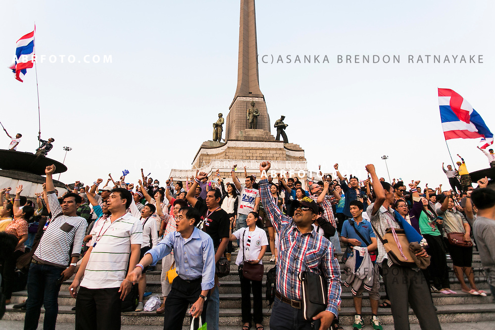 Anti-Thai government protestors (PDRC) raise their arms in support during a rally at the Victory Monument.