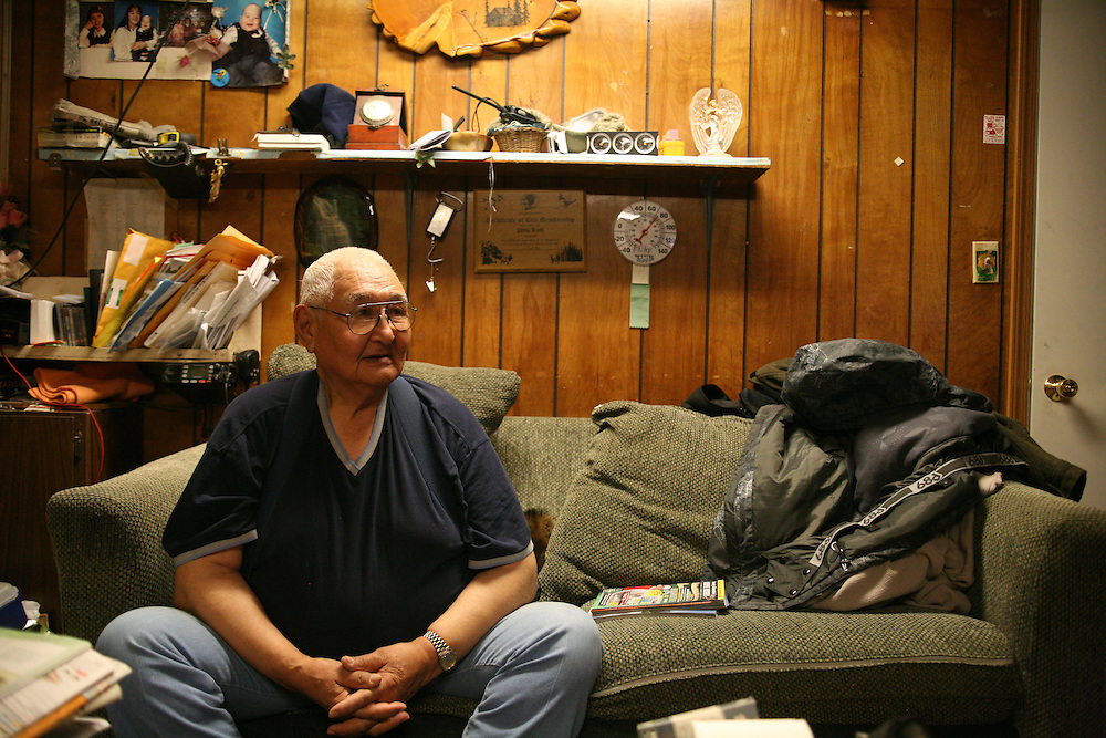 Philip Booth SR in his home in Noatak, Alaska.