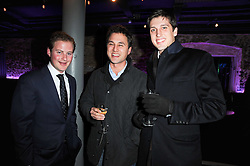 Left to right, GUY PELLY, THOMAS VAN STRAUBENAZEE and JAKE WARREN at the launch party for the new nightclub Public at 533 Kings Road, London on 2nd December 2010.