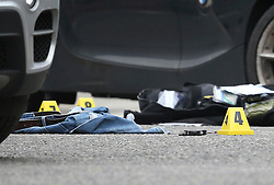 © Licensed to London News Pictures. 15/10/2015. London, UK. Clothing and a set of police handcuffs lie in the road near Scriven Street in Hackney, east London where a male police officer was shot during an authorised firearms operation by the Trident gang crime unit of the Metropolitian Police.  A man has been arrested at the scene. Photo credit: Peter Macdiarmid/LNP