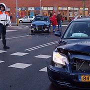 Ongeval graaf Wichman - Eemlandweg Huizen.politie, motor, schade, koplamp, krusing, ongeluk, agent, verkeer regelen,
