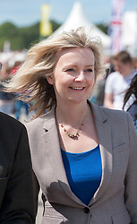 © Licensed to London News Pictures. 28/05/2015. Shepton Mallet, Somerset, UK.  Liz Truss Secretary of State for DEFRA, visits the Royal Bath & West Show, the biggest annual farming show in England. She is urging cheese producers to go for protected status for cheese to compete with continental Europe, to make the UK the world's number one cheese destination ahead of France and Italy.  Photo credit : Simon Chapman/LNP