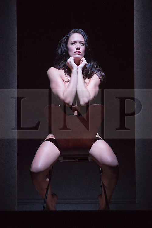 """© Licensed to London News Pictures. 01/11/2013. London, England. Picture: Sarah Armstrong as Christine Keeler in the famous chair pose. The play """"Keeler"""", the inside story of the Profumo Affair based on the book """"The Truth at Last"""" by Christine Keeler opens at the Charing Cross Theatre with Sarah Armstrong as Christine Keeler and Paul Nicholas as Stephen Ward. The play is scheduled to run from 31 October to 14 December 2013. Photo credit: Bettina Strenske/LNP"""