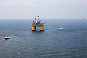 """Offshore Oil platform """"OLYMPUS"""" being positioned off the coast of Louisiana in the Gulf of Mexico by Crowley Maritime Corporation's OCEAN CLASS Tugs. (Aerial Photography by Tim Burdick)"""