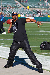 Jan 1, 2012; Oakland, CA, USA; Recording artist M.C. Hammer on the sidelines before the game between the Oakland Raiders and the San Diego Chargers at O.co Coliseum. San Diego defeated Oakland 38-26. Mandatory Credit: Jason O. Watson-US PRESSWIRE