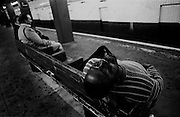 """Asleep in a subway station. Lower East Side...Part of long-term (2005-2008) story """"I See A Darkness"""". New York, NY."""