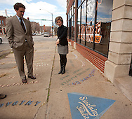 Czech Village Main Street Board president Brian Fagan (from left) and Cedar Rapids Historic Preservation Commission chair Maura Pilcher talk about signage on the sidewalks in the New Bohemia area of Cedar Rapids, Iowa on Thursday, November 11, 2010.