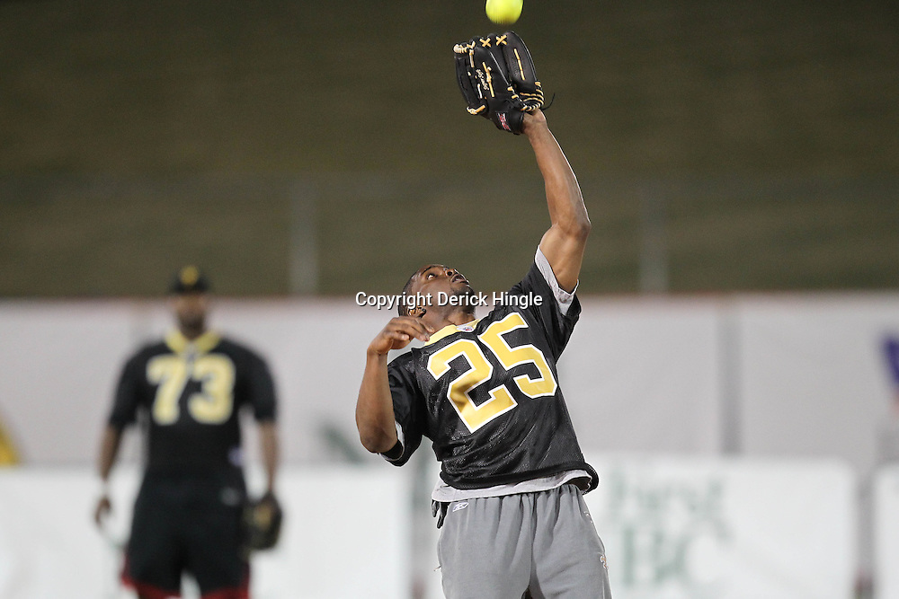 May 17, 2011; Metairie, LA, USA; New Orleans Saints running back Reggie Bush (25) catches a fly ball during the Heath Evans Foundation charity softball showdown featuring the offense versus the defensive players at Zephyrs Field.  Mandatory Credit: Derick E. Hingle