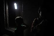 Two kids coming back home in the Beach refugge camp in north Gaza Strip. Due bambini tornano a casa nei vicoli del campo rifugiati di Al Shate'