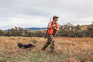 Using a game sled, successful backcountry hunter Jack Crowley drags a nice mule deer buck out of the hills east of Dillon, Montana.