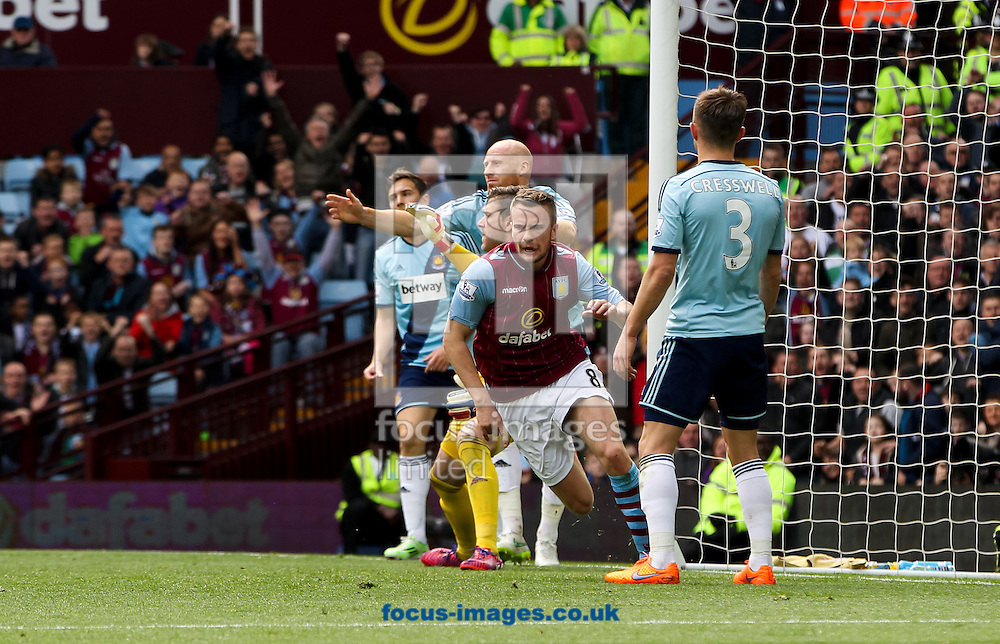 Tom Cleverley (2nd right) of Aston Villa celebrates scoring his sides first goal during the Barclays Premier League match at Villa Park, Birmingham<br /> Picture by Tom Smith/Focus Images Ltd 07545141164<br /> 09/05/2015