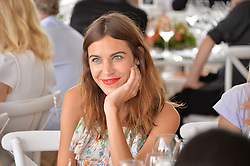 ALEXA CHUNG at the Veuve Clicquot Gold Cup Final at Cowdray Park Polo Club, Midhurst, West Sussex on 20th July 2014.