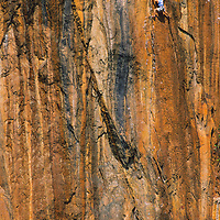 Tamotsu Sugino climbs orange limestone on Mr. Thavidet, 5.12b, Ban Pak Ou, Luang Phrabang, Laos