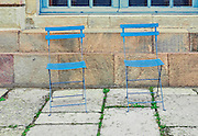 Two empty blue metal chairs outdoors waiting for someone to sit down and rest, Stockholm, Sweden, Europe