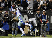 Dec 17, 2017; Oakland, CA, USA; Dallas Cowboys cornerback Anthony Brown (30) is unable to make a catch in front of Oakland Raiders wide receiver Michael Crabtree (15) during an NFL football game at Oakland-Alameda County Coliseum.