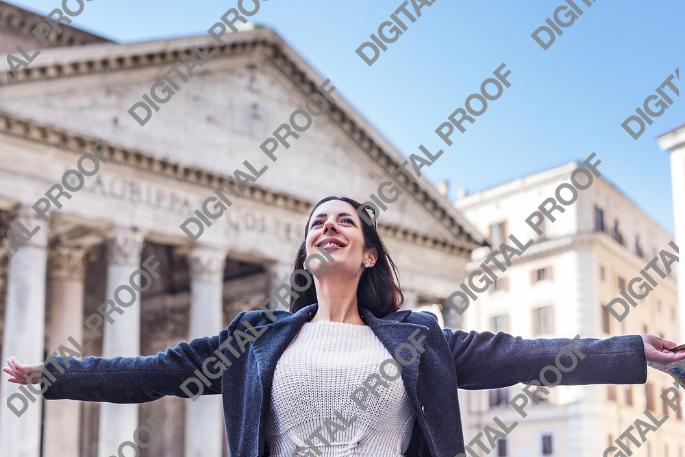 Suscessful tourist woman celebrates with open arms and smile at Pantheon in Rome