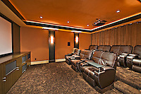 Media room with leather furniture in luxury mansion