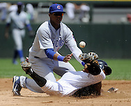 CHICAGO - JUNE 27:  Juan Pierre #1 of the Chicago White Sox steals second base as Starlin Castro #13 of the Chicago Cubs cannot catch the ball on June 27, 2010 at U.S. Cellular Field in Chicago, Illinois.  The Cubs defeated the White Sox 8-6.  (Photo by Ron Vesely)