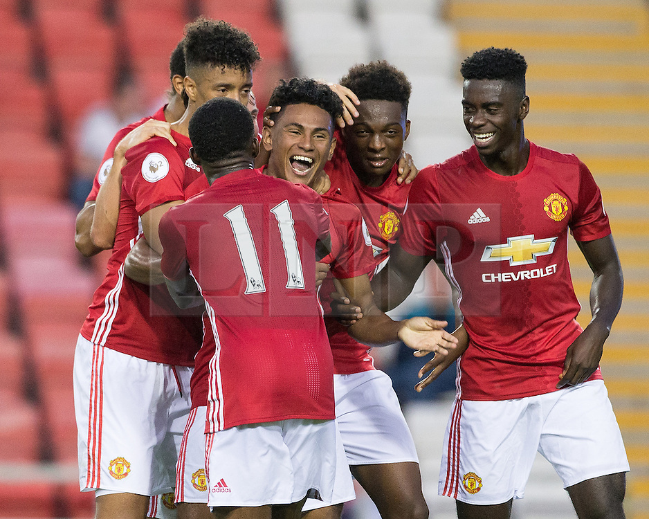 © Licensed to London News Pictures . 15/08/2016 . Leigh , UK . Manchester United players celebrate a late winner by substitute Demetri Mitchell . Manchester United vs Leicester City reserves at Leigh Sports Village Stadium . Photo credit : Joel Goodman/LNP