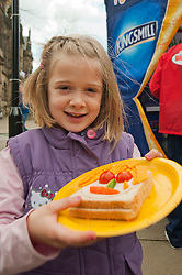 The Kingsmill Big Lunch Tour reaches Sheffield and puts the fun back into lunchtimes as Grac Johnson (7) of Crosspool proudly displays the result of her sandwich making in Fargate Sheffield on Wednesday...http://www.pauldaviddrabble.co.uk.11 April 2012 .Image © Paul David Drabble