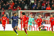 Tottenham Hotspur midfielder Ryan Sessegnon (19)and Bayern Munich midfielder Serge Gnabry (22) race to the ball during the Champions League match between Bayern Munich and Tottenham Hotspur at Allianz Arena, Munich, Germany on 11 December 2019.