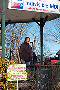 Bar Harbor, Maine, USA. 19 January, 2019. Sirohi Kumar addresses the crowd gathers on the Village Green for the Women's March Bar Harbor, a sister march of the national Women's March.