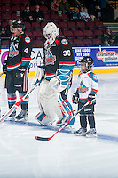 KELOWNA, CANADA - OCTOBER 26: The Pepsi Save on Foods Player of the Game lines up with Michael Herringer #30 of the Kelowna Rockets on October 26, 2016 at Prospera Place in Kelowna, British Columbia, Canada.  (Photo by Marissa Baecker/Shoot the Breeze)  *** Local Caption ***