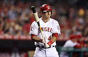 ANAHEIM, CA - APRIL 15:  Mike Trout #27 of the Los Angeles Angels of Anaheim warms up on deck during the game against the Oakland Athletics at Angel Stadium on Tuesday, April 15, 2014 in Anaheim, California. The Athletics won the game 10-9 in eleven innings. (Photo by Paul Spinelli/MLB Photos via Getty Images) *** Local Caption *** Mike Trout