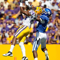 October 1, 2011; Baton Rouge, LA, USA;  LSU Tigers defensive back Tharold Simon (24) breaks up a pass intended for Kentucky Wildcats wide receiver La'Rod King (16) during the first half at Tiger Stadium.  Mandatory Credit: Derick E. Hingle-US PRESSWIRE / © Derick E. Hingle 2011