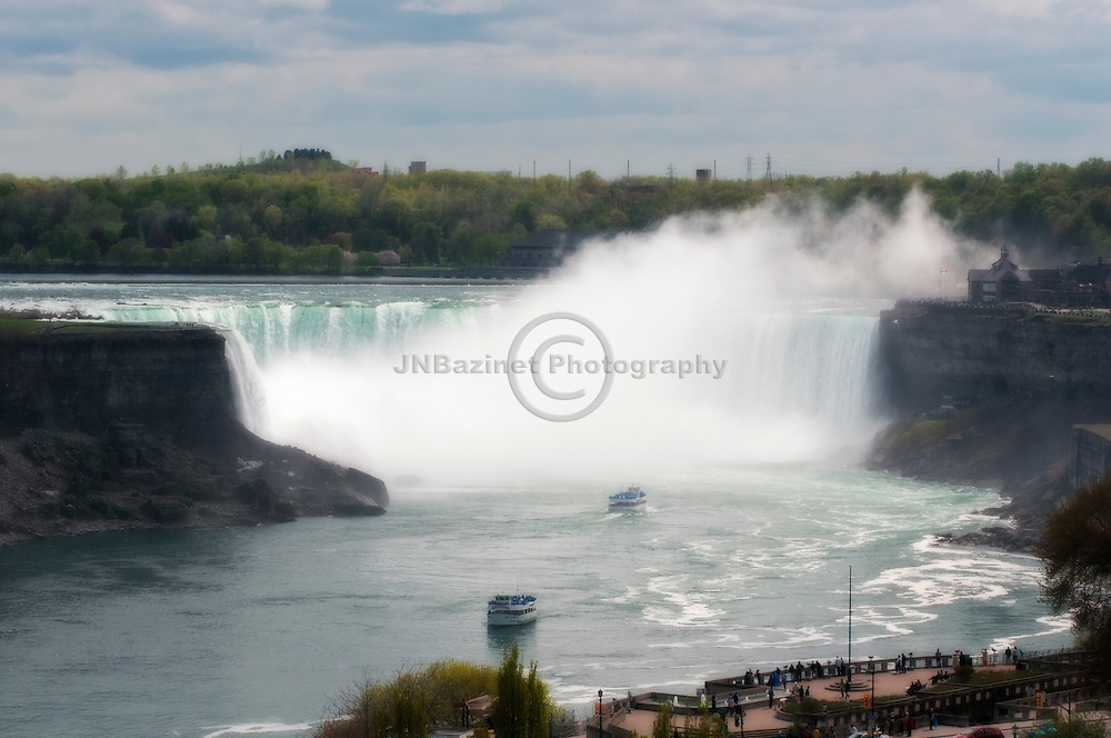 From land and water, tourist view Horseshoe Falls in Niagara, Canada
