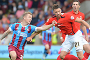 Gary McSheffrey  and Aaron Martin  during the Sky Bet League 1 match between Scunthorpe United and Coventry City at Glanford Park, Scunthorpe, England on 12 September 2015. Photo by Ian Lyall.